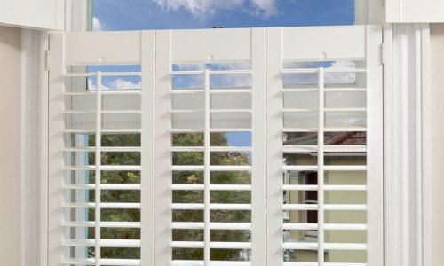 Custom West split shutters
